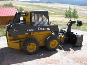 WoodMax SS72 with Armorskids Skid Shoes leftside Deere 320E SkidSteer-4