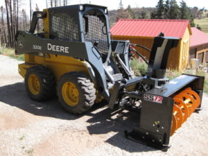 WoodMax SS72 with Armorskids skid shoes rightside Deere 320E Skidsteer-1